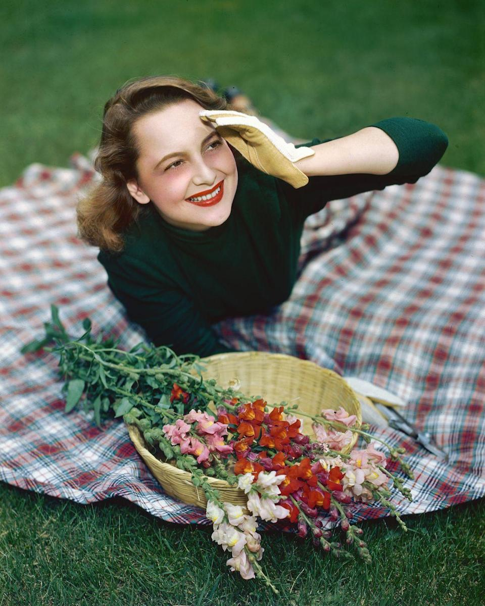 <p>Olivia taking a break from the world in 1945.</p>