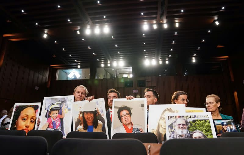 FILE PHOTO: Family members attend as Boeing's Muilenburg testifies before Senate Commerce, Science and Transportation hearing on grounded 737 MAX on Capitol Hill in Washington