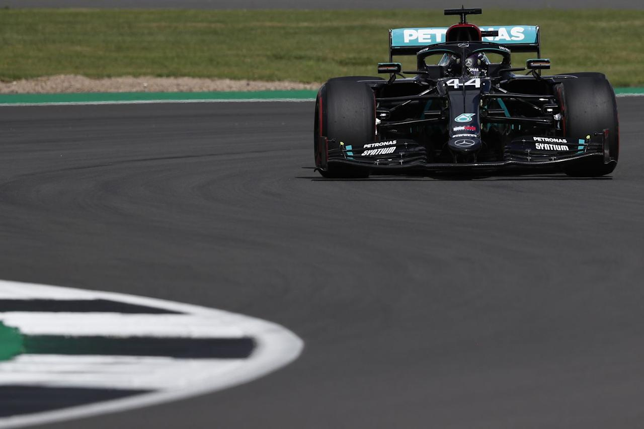 <p>Mercedes' British driver Lewis Hamilton steers his car during the qualifying session for the Formula One British Grand Prix at the Silverstone motor racing circuit in Silverstone, central England on August 1, 2020.</p>