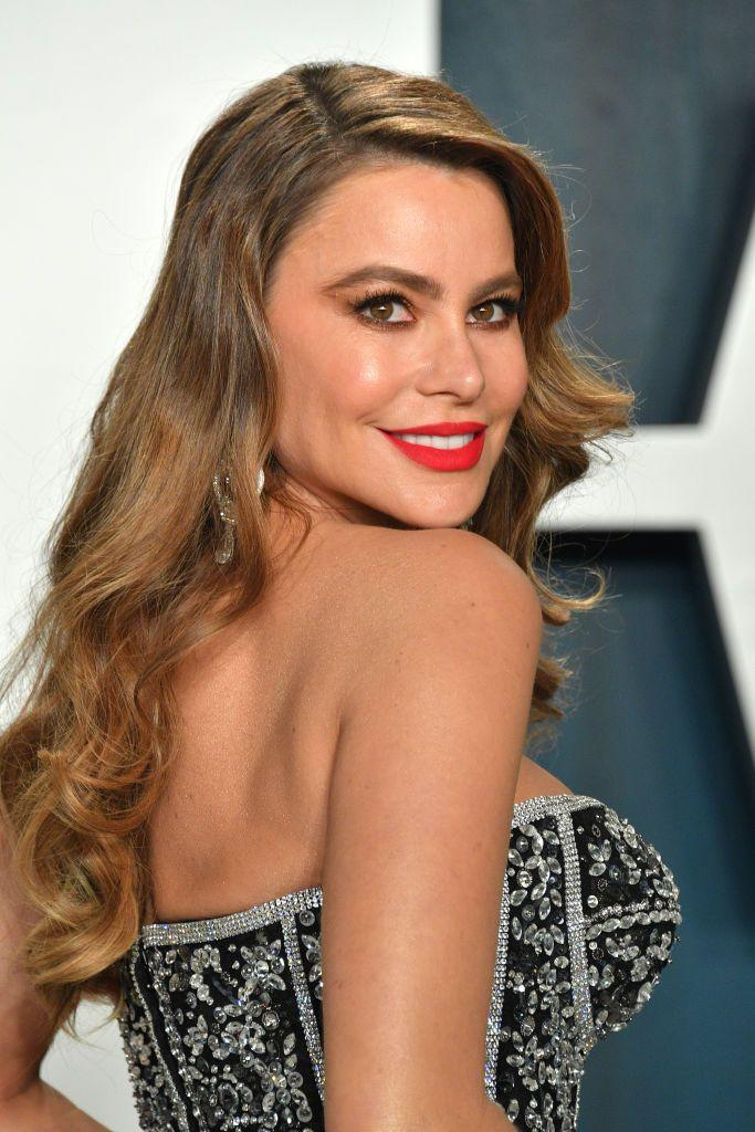 """<p>For more than a decade, Sofia portrayed the outspoken Colombian character Gloria Delgado-Pritchett on <em><a href=""""https://www.goodhousekeeping.com/life/entertainment/a33648261/why-did-modern-family-end-season-11/"""" rel=""""nofollow noopener"""" target=""""_blank"""" data-ylk=""""slk:Modern Family"""" class=""""link rapid-noclick-resp"""">Modern Family</a></em>. Today, fans can see her on <em><a href=""""https://www.goodhousekeeping.com/life/entertainment/a33955912/agt-2020-season-15-semifinal-wildcard-thomas-day/"""" rel=""""nofollow noopener"""" target=""""_blank"""" data-ylk=""""slk:America's Got Talent"""" class=""""link rapid-noclick-resp"""">America's Got Talent</a></em> as a judge. The native Colombian actress has also lent her voice for <em><a href=""""https://www.amazon.com/Emoji-Movie-Anna-Faris/dp/B073X43HG5?tag=syn-yahoo-20&ascsubtag=%5Bartid%7C10055.g.33835500%5Bsrc%7Cyahoo-us"""" rel=""""nofollow noopener"""" target=""""_blank"""" data-ylk=""""slk:The Emoji Movie"""" class=""""link rapid-noclick-resp"""">The Emoji Movie</a></em> and <em><a href=""""https://www.amazon.com/gp/video/detail/B07WPS3GGB/?tag=syn-yahoo-20&ascsubtag=%5Bartid%7C10055.g.33835500%5Bsrc%7Cyahoo-us"""" rel=""""nofollow noopener"""" target=""""_blank"""" data-ylk=""""slk:Family Guy"""" class=""""link rapid-noclick-resp"""">Family Guy</a></em>. What's more, she teamed up with <strong>Reese Witherspoon</strong> for the action comedy <em><a href=""""https://www.amazon.com/Hot-Pursuit-Richard-T-Jones/dp/B00XCGU74S?tag=syn-yahoo-20&ascsubtag=%5Bartid%7C10055.g.33835500%5Bsrc%7Cyahoo-us"""" rel=""""nofollow noopener"""" target=""""_blank"""" data-ylk=""""slk:Hot Pursuit"""" class=""""link rapid-noclick-resp"""">Hot Pursuit</a></em>.</p>"""
