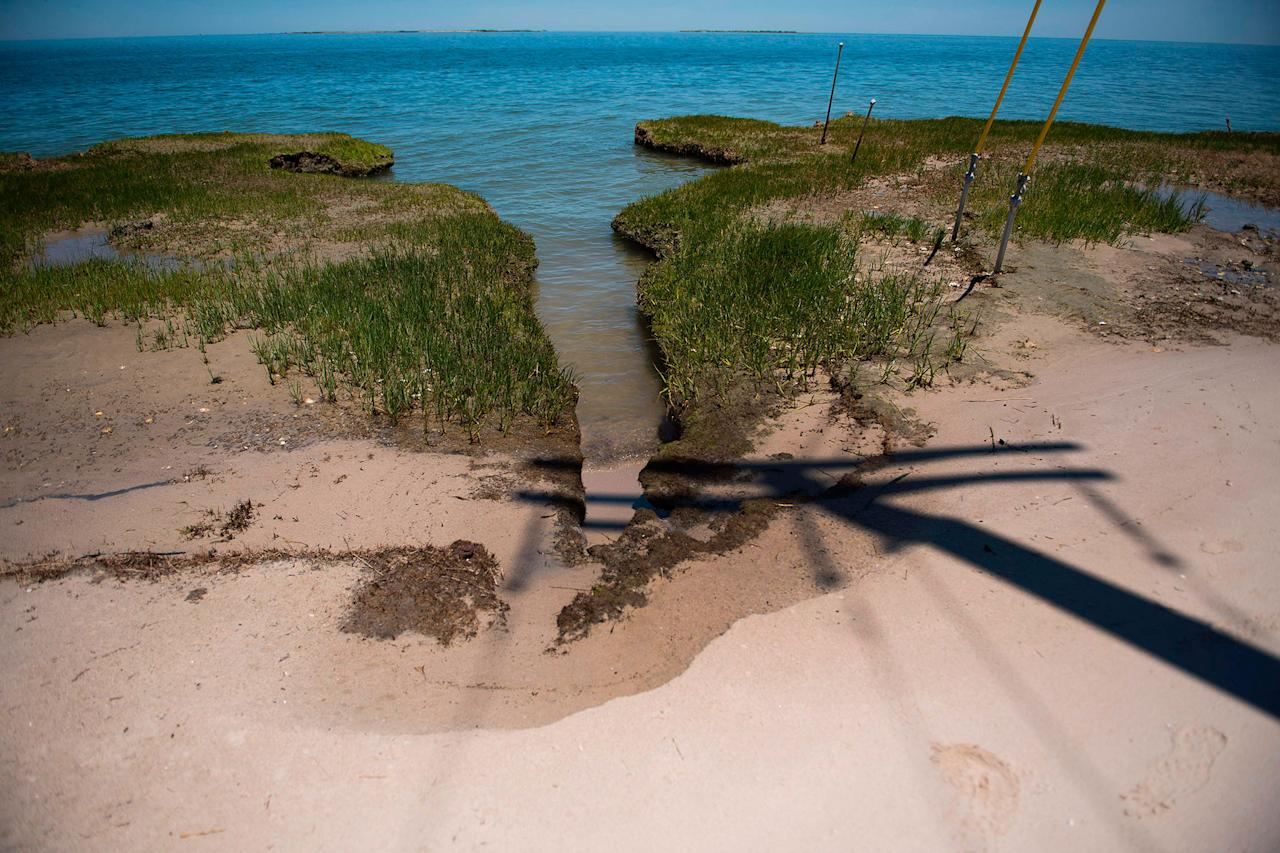 Erosion eats away at the tip of the Uppards in an area called Canaan in Tangier, Virginia, May 16, 2017, where climate change and rising sea levels threaten the inhabitants of the slowly sinking island.<br /> (Jim Watson/AFP/Getty Images)