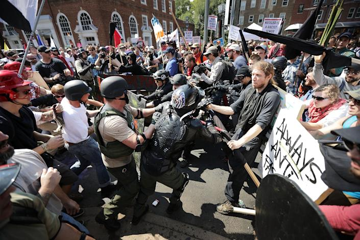 "White nationalists, neo-Nazis and members of the ""alt-right"" clash with counterprotesters as they enter Lee Park during the ""Unite the Right"" on Aug.12, 2017, in Charlottesville, Va. (Photo: Chip Somodevilla/Getty Images)"
