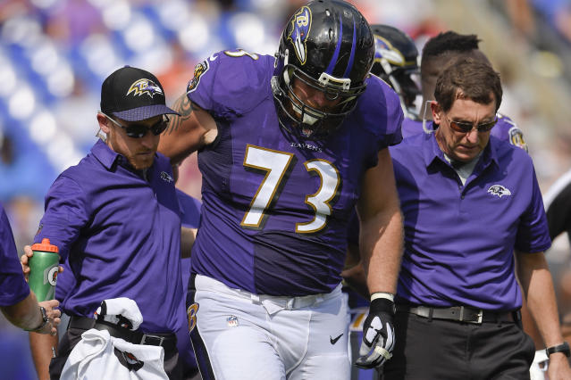 Baltimore Ravens offensive guard Marshal Yanda is helped off the field after an injury last week. (AP)