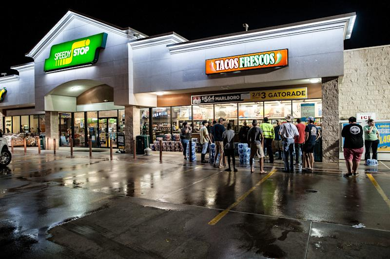 Beaumont residents wait outside a local convenience store after the city loses its water supply. (Joseph Rushmore for HuffPost)