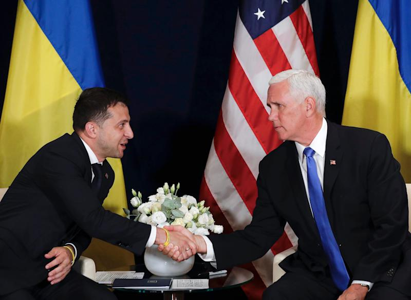 Ukraine's President Volodymyr Zelensky shakes hands with U.S. Vice President Mike Pence, in Warsaw, Poland on Sept. 1, 2019.