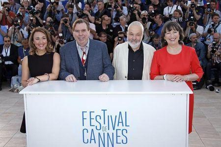 "Director Mike Leigh, cast members Dorothy Atkinson, Timothy Spall and Marion Bailey pose during a photocall for the film ""Mr. Turner"" in competition at the 67th Cannes Film Festival in Cannes"