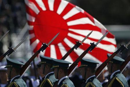 Japan Self-Defence Forces' troops march during the annual SDF troop review ceremony at Asaka Base in Asaka, Japan