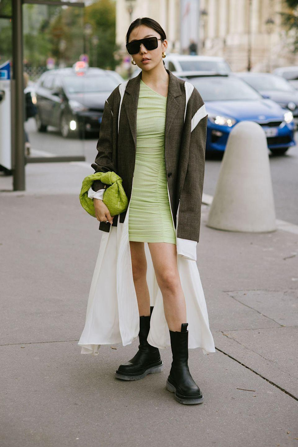 """<p>If you're itching to dust off your <a href=""""https://www.cosmopolitan.com/uk/fashion/style/g10000448/best-summer-dresses/"""" rel=""""nofollow noopener"""" target=""""_blank"""" data-ylk=""""slk:summer dresses"""" class=""""link rapid-noclick-resp"""">summer dresses</a> before we make it to the sunny season, pair them with your favourite chunky <a href=""""https://www.cosmopolitan.com/uk/fashion/style/g34191028/best-womens-boots/"""" rel=""""nofollow noopener"""" target=""""_blank"""" data-ylk=""""slk:leather boots"""" class=""""link rapid-noclick-resp"""">leather boots</a>, in the meantime. The stomper that hits at mid-calf goes well with both maxi and mini dresses alike.</p>"""