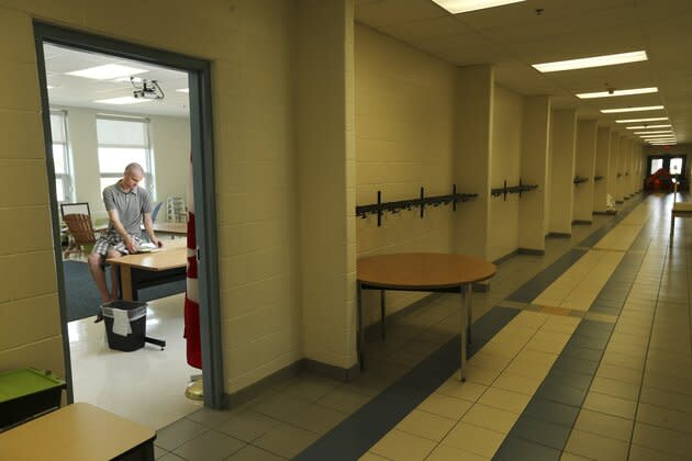 A teacher organizes his empty classroom in a Brampton, Ont. school in Aug. 31, 2015.