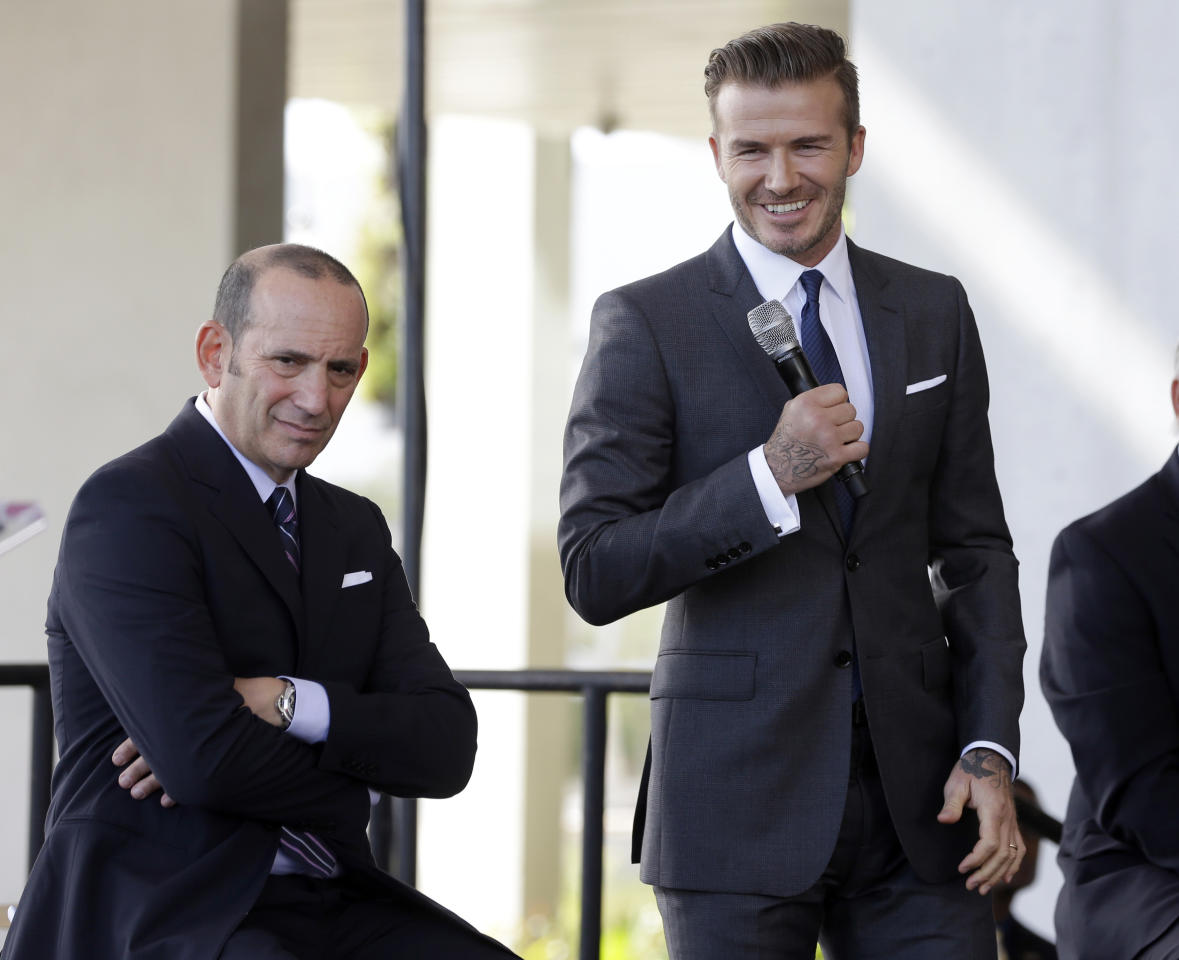 FILE - In this Feb. 5, 2014, file photo, former England soccer star David Beckham, right, and MLS Commissioner Don Garber listens to a question at a news conference in Miami, The Beckham-led group unveleiled plans this month for a privately financed, 25,000-seat stadium in the city's Overton area. The ownership group still needs the city to sign off on a part of the land deal, a decision that could come as early as June 6, 2017, when the measure goes up for vote. The stadium would not open until 2021. (AP Photo/Lynne Sladky, File)