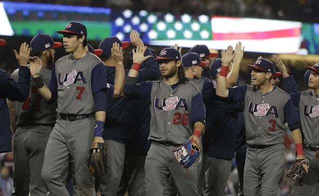 <p>United States celebrates after defeating Japan, 2-1, in a semifinal in the World Baseball Classic in Los Angeles, Tuesday, March 21, 2017. (AP Photo/Chris Carlson) </p>