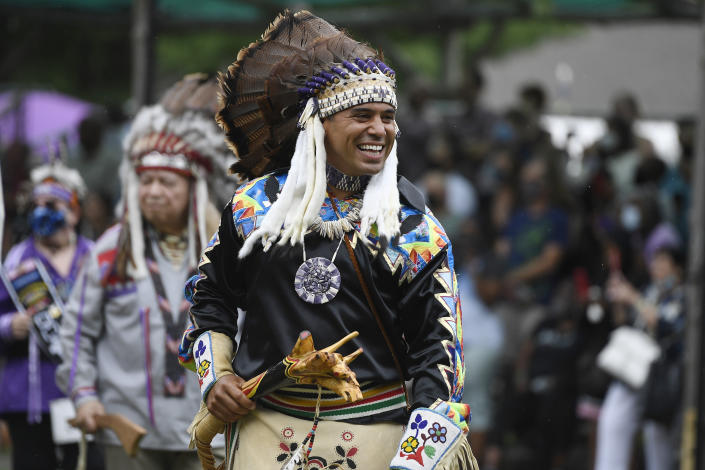 Rodney Butler, Chairman of the Mashantucket Pequot Tribal Nation, participates in the Schemitzun grand entry on Mashantucket Pequot Reservation, in Mashantucket, Conn., Wednesday, Aug. 28, 2021. Connecticut and a handful of other states have recently decided to mandate students be taught about Native American culture and history. (AP Photo/Jessica Hill)