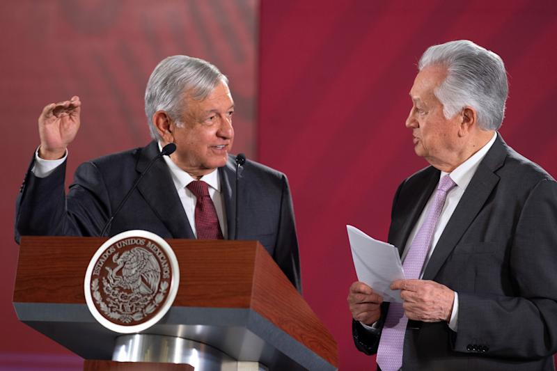Mexico's President Andres Manuel Lopez Obrador chat with the head of the Federal Electricity Commission (CFE) Manuel Bartlett during an event where the government reached a deal with companies to renegotiate the terms of natural gas pipeline contracts signed under the previous administration, at National Palace in Mexico City, Mexico August 27, 2019. Press Office Andres Manuel Lopez Obrador/Handout via REUTERS ATTENTION EDITORS - THIS IMAGE WAS PROVIDED BY A THIRD PARTY