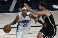Orlando Magic's Markelle Fultz (20) heads to the basket as Brooklyn Nets' Joe Harris, right, defends during the first half of an NBA basketball game Friday, July 31, 2020, in Lake Buena Vista, Fla. (AP Photo/Ashley Landis, Pool)
