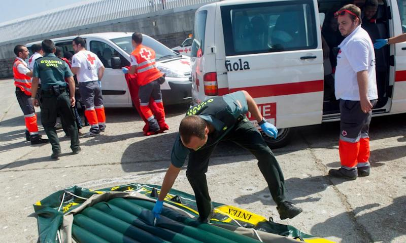A Guardia Civil officer checks an inflatable boat left behind by migrants trying to cross the Mediterranean. The Spanish government said the situation is 'overwhelming'.