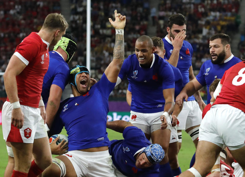France's Sebastien Vahaamahina, center left, celebrates with teammates after scoring a try against Wales during the Rugby World Cup quarterfinal match at Oita Stadium in Oita, Japan, Sunday, Oct. 20, 2019. (AP Photo/Christophe Ena)