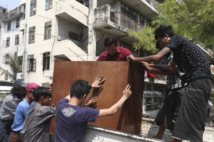 State railway employees load furniture in to a truck after being evicted from their home Saturday, March 20, 2021, in Mandalay, Myanmar. State railway workers in Mandalay have been threatened with eviction to force them to end their support for the Civil Disobedience Movement (CDM) against military rule. (AP Photo)