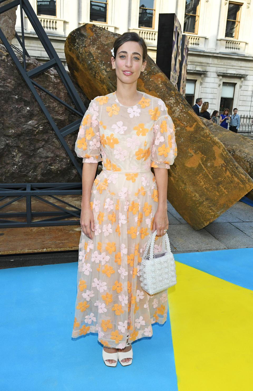 <p>Laura Jackson donned a seriously stylish dress by Simone Rocha accessorised with the must-have Shrimps 'It' bag. Love. <em>[Photo: Getty]</em> </p>