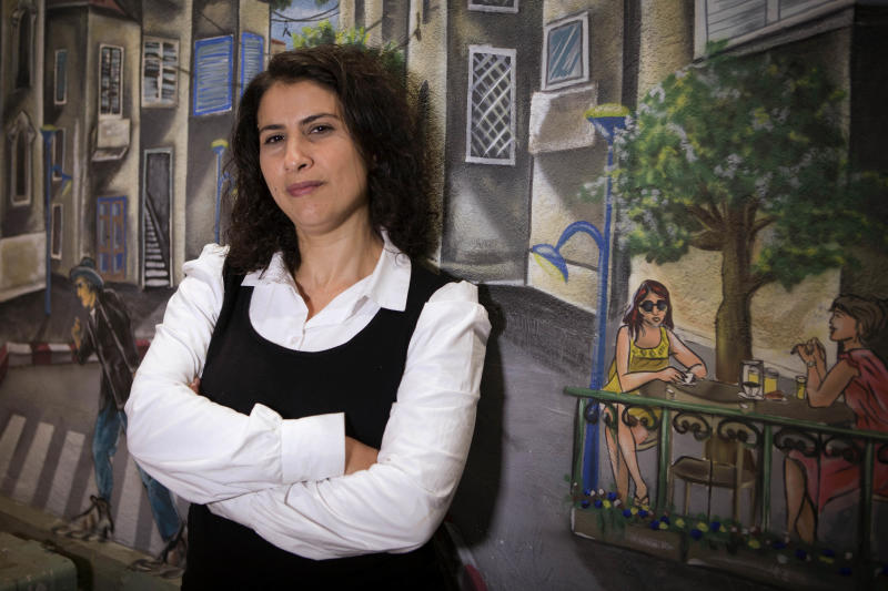 Asma Aghbaria-Zahalka, the head of Daam Party, poses for a photograph  in Tel Aviv, Israel, Thursday, Jan. 17, 2013. Aghbaria-Zahalka, an Arab woman who's been toiling on the fringes of Israeli politics for nearly two decades has broken out of obscurity in this year's election with a non-conformist message that's resonating with protest voters. (AP Photo/Dan Balilty)