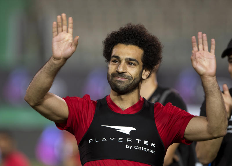 Salah greets fans who turned up at his doorstep