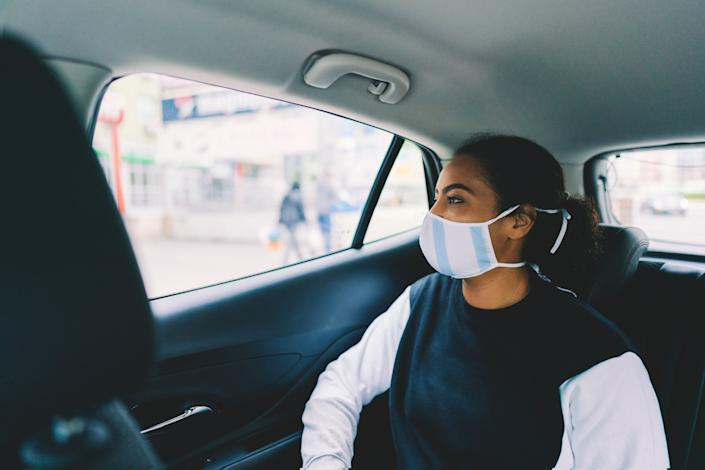 There are important factors to keep in mind and ways to mitigate the risks when it comes to taking a taxi or rideshare service during the COVID-19 pandemic. (Photo: martin-dm via Getty Images)