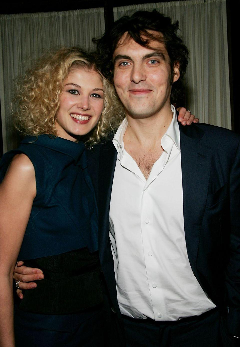 """<p>The two met in 2005 when Pike was starring in <em>Pride and Prejudice </em>(and <span class=""""redactor-invisible-space"""">when Wright served as director for the film.) He <a href=""""http://www.marieclaire.co.uk/news/celebrity-news/rosamund-pike-and-joe-wright-engaged-207910"""" rel=""""nofollow noopener"""" target=""""_blank"""" data-ylk=""""slk:proposed in 2007"""" class=""""link rapid-noclick-resp"""">proposed in 2007</a> two days before the Venice Film Festival, but they parted ways in June 2008. </span></p>"""