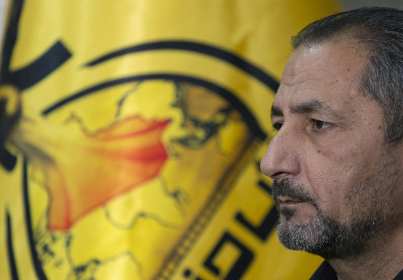 "Mohammed Mohieh, the spokesman of Iraq's Iranian-backed Kataeb Hezbollah, or Hezbollah Brigades, gives an interview at his office, in Baghdad, Iraq, Monday, Dec. 30, 2019. Mohieh said Monday that the death toll from U.S. military strikes in Iraq and Syria against its fighters has risen to 25, vowing to exact revenge for the ""aggression of evil American ravens."" (AP Photo/Nasser Nasser)"
