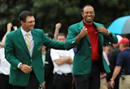 Tiger Woods (R) of the United States is awarded the Green Jacket by Masters champion Patrick Reed (L) during the Green Jacket Ceremony after winning the Masters at Augusta National Golf Club on April 14, 2019 in Augusta, Georgia. (Photo by Mike Ehrmann/Getty Images)