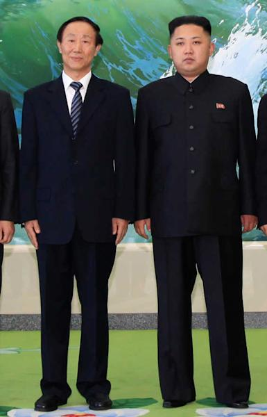 In this photo taken Thursday, Aug. 2, 2012, North Korean leader Kim Jong Un, right, poses for a photo with Wang Jiarui, head of the International Department of the Chinese Communist Party, in Pyongyang, North Korea. Kim met with senior political officials from China in a sign that he may be turning his attention to foreign diplomacy. (AP Photo/Xinhua, Zhang Li) NO SALES