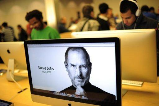 A photo of Apple's founder Steve Jobs is displayed at Apple's flagship store on New York's 5th Avenue. Apple founder and visionary Jobs has died from cancer aged just 56, a premature end for a man who revolutionized modern culture and changed forever the world's relationship to technology through inventions such as the iPad and iPhone