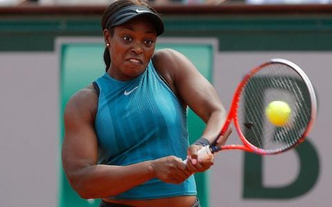 Sloane Stephens, of the United States, returns a shot against Romania's Simona Halep in the finals of the French Open tennis tournament at the Roland Garros stadium in Paris, France. - Credit: AP