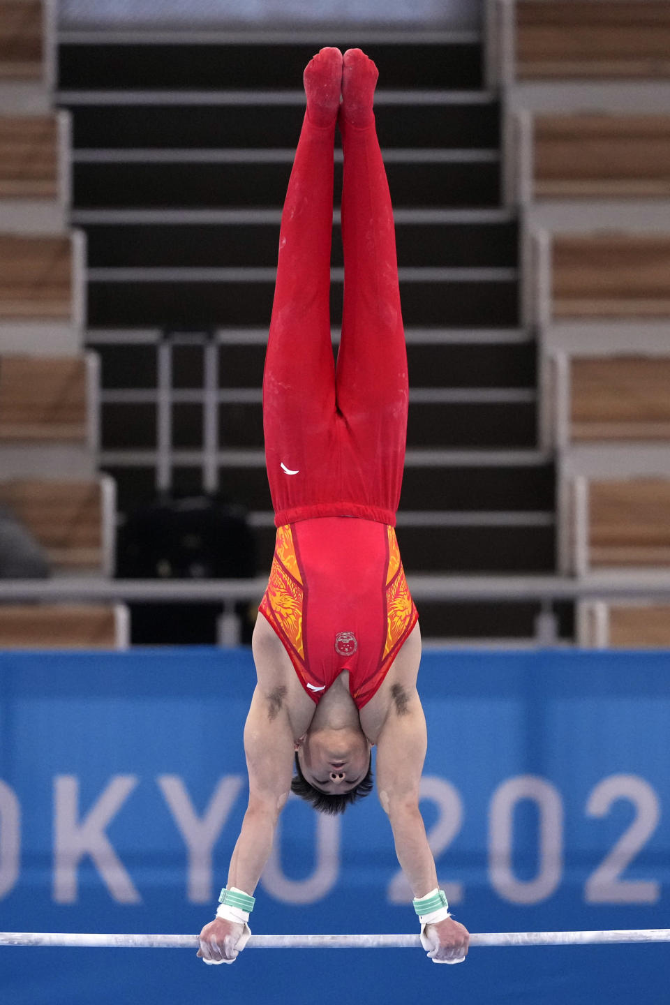 China's Sun Wei performs on the horizontal bar during the men's artistic gymnastic qualifications at the 2020 Summer Olympics, Saturday, July 24, 2021, in Tokyo. (AP Photo/Ashley Landis)