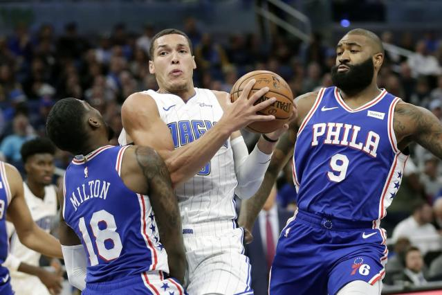 Magic catch fire, pull away for home win over 76ers