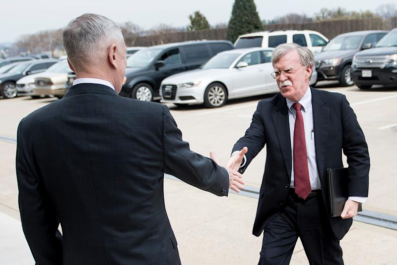 Secretary of Defense Jim Mattis, left, greets incoming national security adviser John Bolton outside the Pentagon on March 29. Bolton's new deputy had been a thorn in Mattis' side when he was filling out his staff. (BRENDAN SMIALOWSKI via Getty Images)
