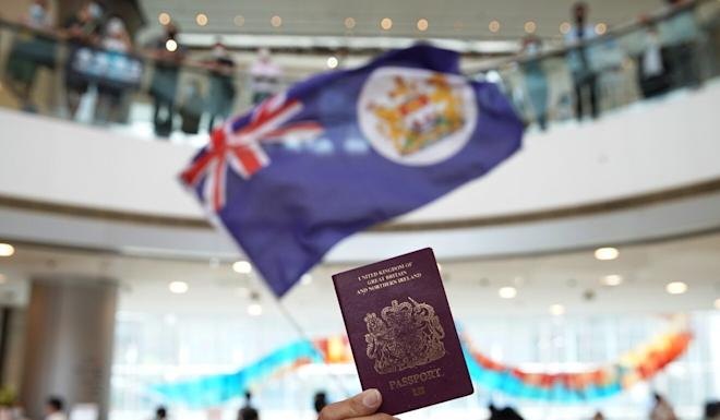 A protester holds a BN (O) passport during a lunch-hour anti-government demonstration at the IFC shopping mall in Central earlier this year. Photo: Winson Wong