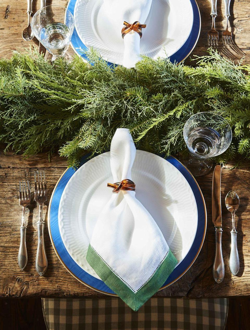 <p>Adding a simple, unadorned evergreen garland feels festive and autumnal without screaming Christmas. Mix in a few fall leaves for a little extra oomph.</p>
