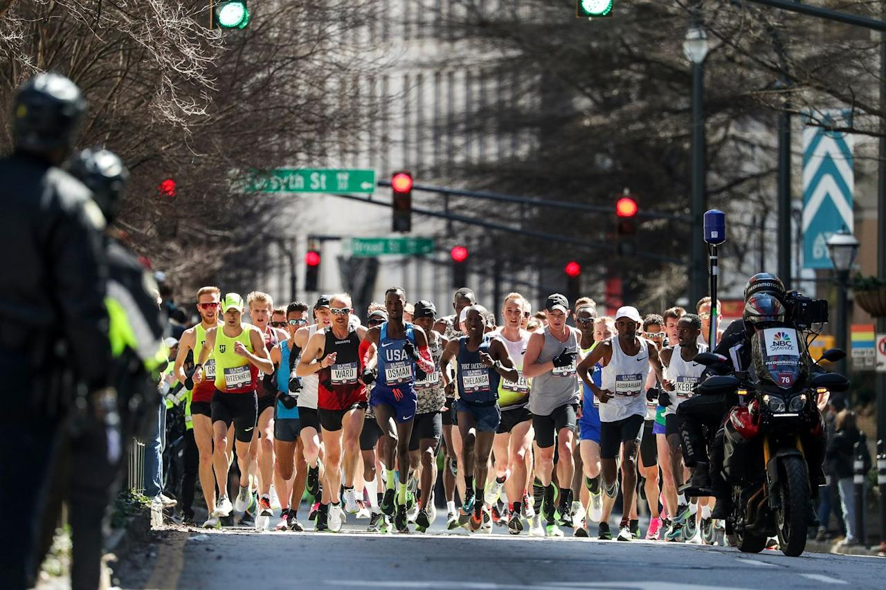 <p>Eventual third-place finisher Abdi Abdirahman (right, wearing cap) gets off well.</p>