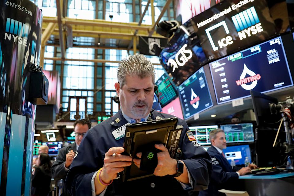 The Dow Jones Industrial average is displayed on a screen after the closing bell at the New York Stock Exchange, (NYSE) in New York, U.S., April 10, 2018. REUTERS/Brendan McDermid