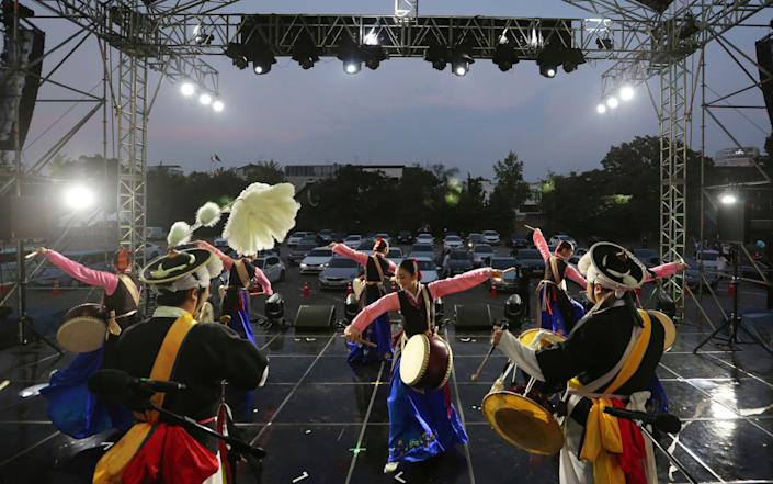 Dancers perform at a drive-in concert at Gyeongbok Palace parking lot in Seoul, South Korea - AP