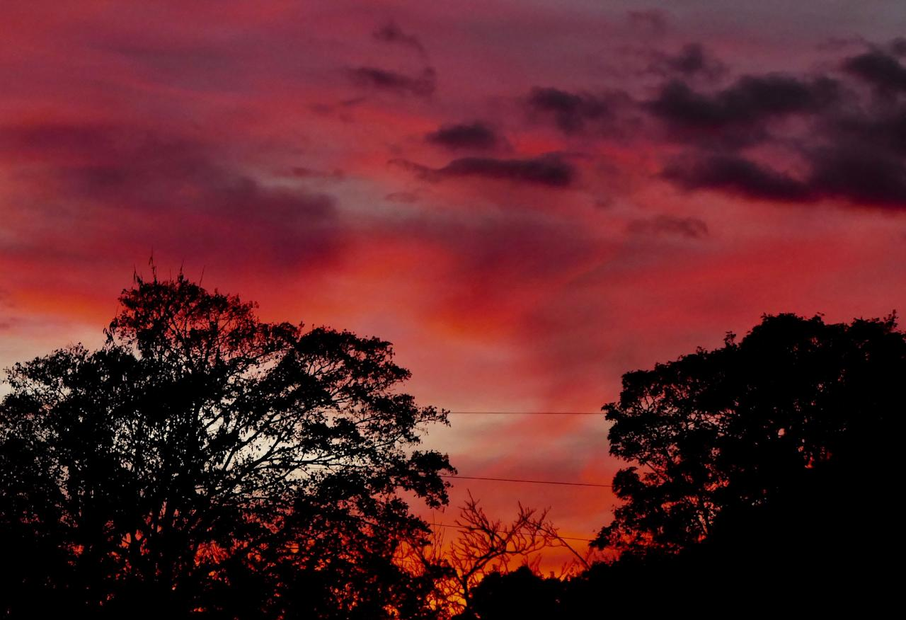 <p>Red sky at night over Henley on Thames Oxfordshire. (Rex) </p>