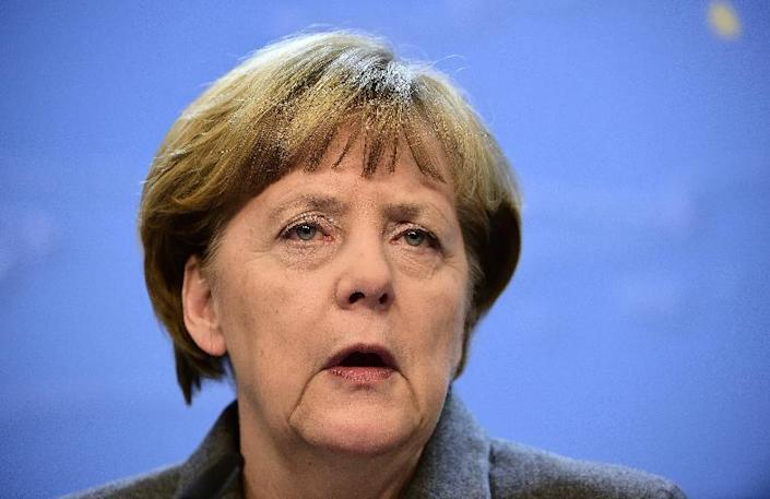 German Chancellor Angela Merkel speaks during a press conference at the end of an European Council leaders summit in Brussels on February 12, 2015 (AFP Photo/Emmanuel Dunand)