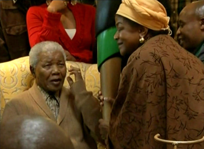This video image taken from SABC television shows South Africa's former president Nelson Mandela, left, receiving a torch to celebrate the African National Congress' centenary from ANC chairperson Baleka Mbete in Mandela's home village Qunu in rural eastern South Africa Wednesday May 30, 2012. Nelson Mandela's African National Congress brought its centenary celebrations to his home village in rural eastern South Africa. (AP Photo/SABC via AP video) SOUTH AFRICA OUT