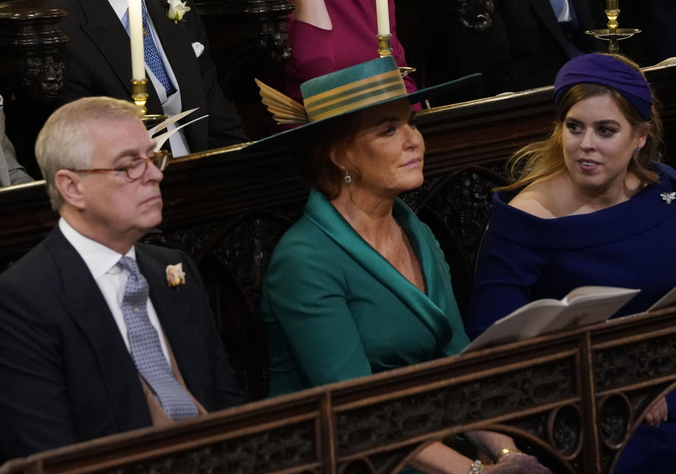 Prince Andrew, Duke of York Sarah Ferguson and Princess Beatrice of York attend of the wedding of Princess Eugenie of York and Mr. Jack Brooksbank at St. George's Chapel on October 12, 2018 in Windsor, England.
