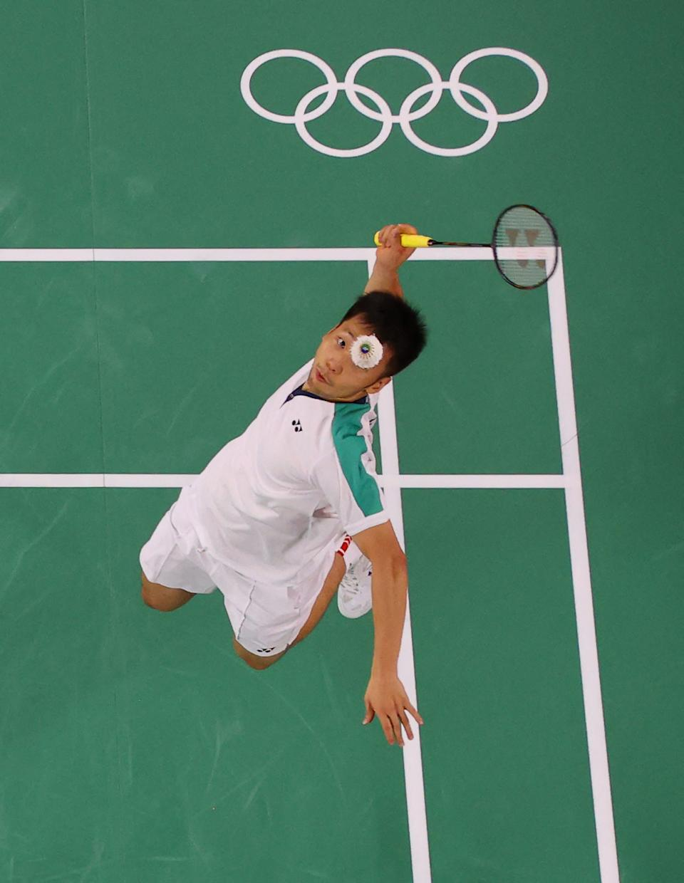 <p>Taiwan's Lee Yang hits a shot next to Taiwan's Wang Chi-lin in their men's doubles badminton final match against China's Li Junhui and China's Liu Yuchen during the Tokyo 2020 Olympic Games at the Musashino Forest Sports Plaza in Tokyo on July 31, 2021. (Photo by LINTAO ZHANG / POOL / AFP) (Photo by LINTAO ZHANG/POOL/AFP via Getty Images)</p>