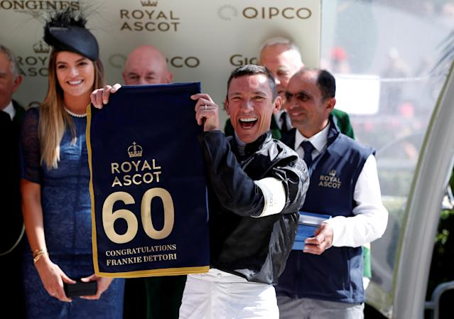 REFILE - CORRECTING TYPO Horse Racing - Royal Ascot - Ascot Racecourse, Ascot, Britain - June 21, 2018 Frankie Dettori poses with a banner commemorating his 60th Royal Ascot win Action Images via Reuters/Paul Childs