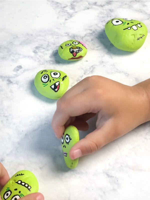 "<p>Rocks rock! Collect a few smooth stones from the yard and encourage your kids to transform them with silly and scary faces. </p><p><strong>Get the tutorial at <a href=""https://www.simpleeverydaymom.com/zombie-halloween-painted-rocks-for-kids/"" rel=""nofollow noopener"" target=""_blank"" data-ylk=""slk:Simple Everyday Mom"" class=""link rapid-noclick-resp"">Simple Everyday Mom</a>.</strong></p><p><strong><a class=""link rapid-noclick-resp"" href=""https://www.amazon.com/Painting-Ceramic-Acrylic-Markers-Extra-fine/dp/B07D2LC8LH/?tag=syn-yahoo-20&ascsubtag=%5Bartid%7C2139.g.34440360%5Bsrc%7Cyahoo-us"" rel=""nofollow noopener"" target=""_blank"" data-ylk=""slk:SHOP PAINT PENS"">SHOP PAINT PENS</a><br></strong></p>"