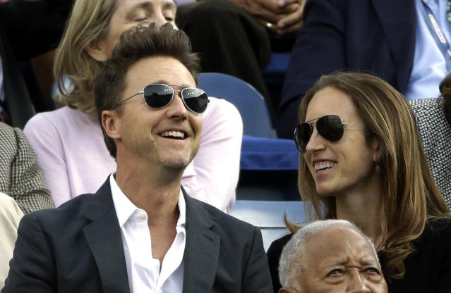 Actor Edward Norton, left, watches play between Spain's Rafael Nadal and Serbia's Novak Djokovic during the men's singles final of the 2013 U.S. Open tennis tournament, Monday, Sept. 9, 2013, in New York. (AP Photo/David Goldman)