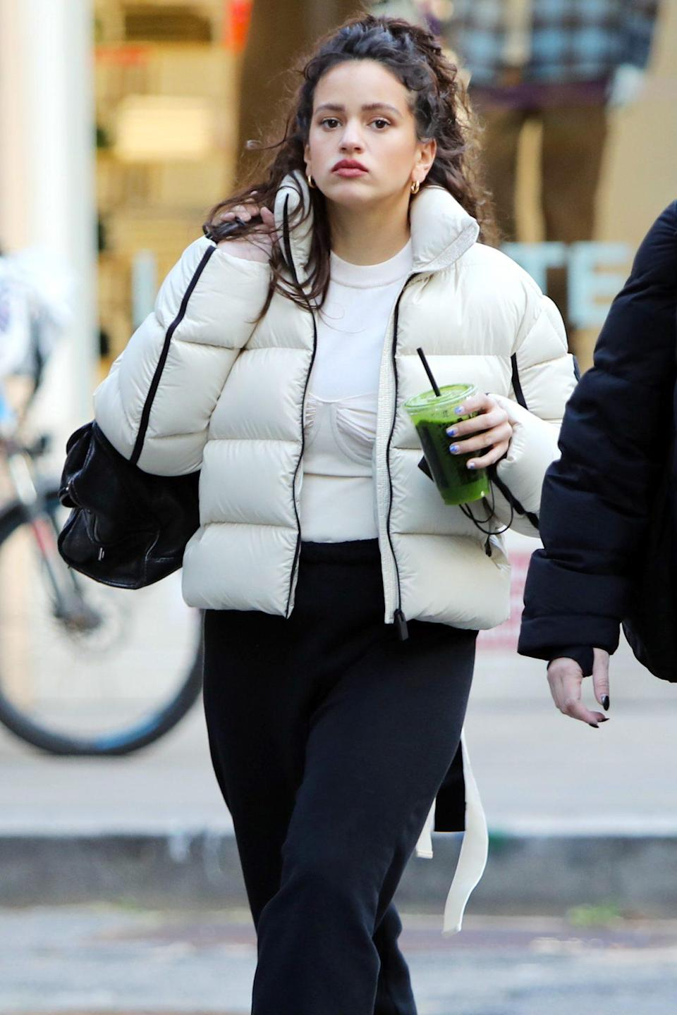 <p>A bundled Rosalía grabs a green juice on Tuesday in New York City.</p>