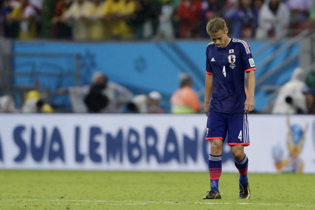 Japan's Keisuke Honda leaves the pitch after the group C World Cup soccer match between Ivory Coast and Japan at the Arena Pernambuco in Recife, Brazil, Saturday, June 14, 2014. Ivory Coast won 2-1. (AP Photo/Ricardo Mazalan)