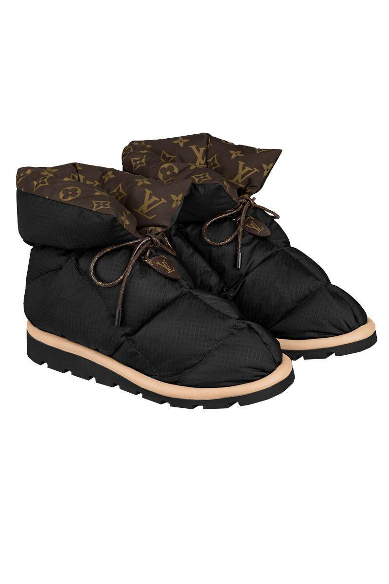 """<p><strong>Louis Vuitton</strong></p><p>louisvuitton.com</p><p><strong>$1140.00</strong></p><p><a href=""""https://us.louisvuitton.com/eng-us/products/pillow-comfort-ankle-boot-nvprod2600043v"""" rel=""""nofollow noopener"""" target=""""_blank"""" data-ylk=""""slk:SHOP IT"""" class=""""link rapid-noclick-resp"""">SHOP IT</a></p><p>Louis Vuitton makes dressing for winter fun again with its pillow ankle boots. They're made with water-repellent nylon and a warm down filling to protect your from the winter elements when it gets real rough outdoors. Of course the logo-covered inner layer is the real eye-catcher and should you not want to wear these outside, you can use them as extra fancy house slippers.<br></p>"""